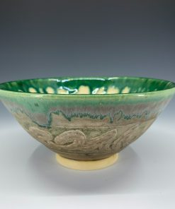 Green glossy drips turn into blues as they flow onto the matte brown on this traditional bowl.